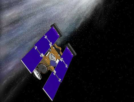 Recreación artística de la sonda Stardust atravesando la cola del cometa.   NASA - JPL.