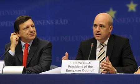 Barroso y el presidente sueco, Frank Reinfeldt. | AFP