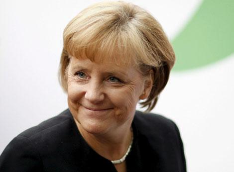 Merkel, satisfecha tras cerrar el acuerdo de Gobierno. | Efe