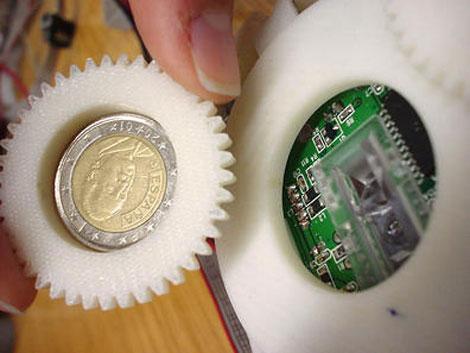 Sensor de ratón óptico y moneda. | UdL.