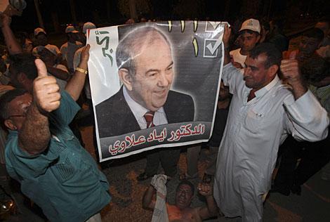 Partidarios de Alawi salen a la calle este viernes para celebrar su victoria. | AP