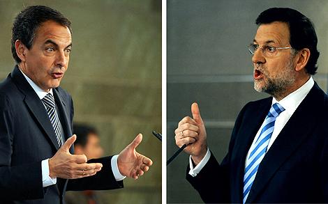 Zapatero y Rajoy, en sus respectivas comparecencias tras la reunión.   AFP