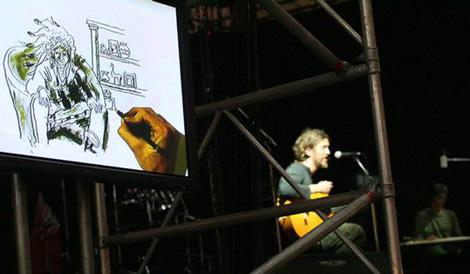 Guillaume Trouillard dibuja y su hermano Antonie toca la guitarra.