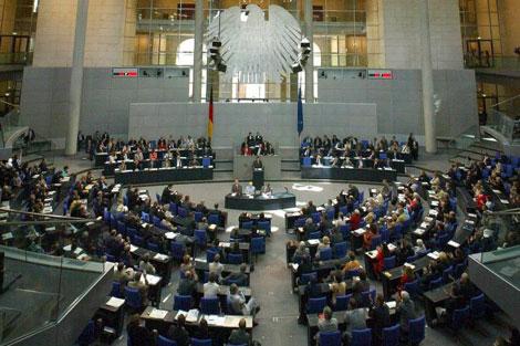 Los diputados alemanes, durante un pleno en el edificio del Reichstag. | Ap