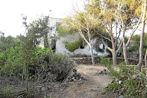 Una de las viviendas enclavada en el islote.