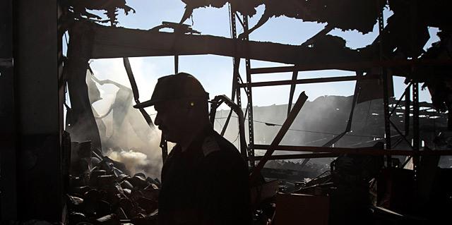 El régimen de Gadafi ha mostrado el resultado de un ataque. | AP