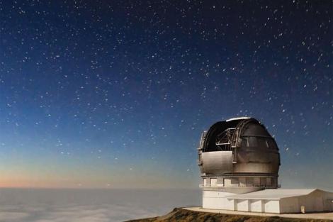 Foto del cartel del Starmus Festival con el Gran Telescopio de Canarias.