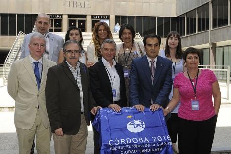 Los miembros de la candidatura cordobesa, en el Museo del Traje. | M. Cubero