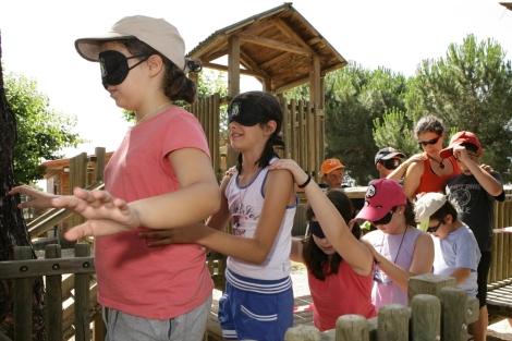 Niños jugando en uno de los campamento de verano.| ONCE