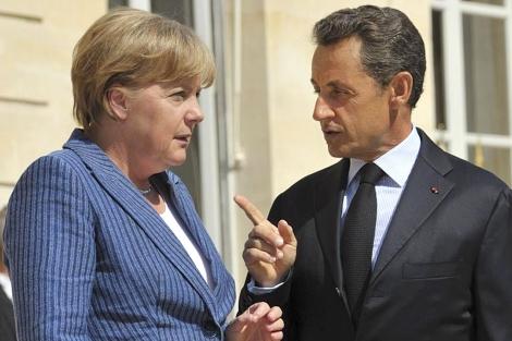 Sarkozy y Merkel, en el Palacio del Elíseo. | Reuters