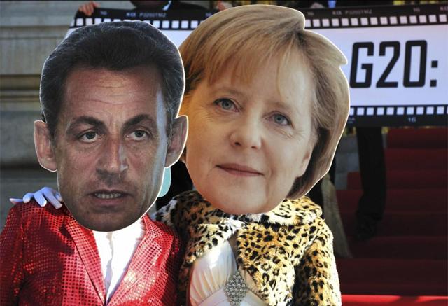 Manifestantes contra el G-20, disfrazados de Sarkozy y Merkel. | Reuters