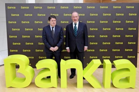 José Luis Olivas, junto a Rodrigo Rato, durante la presentación de Bankia.   Vicent Bosch