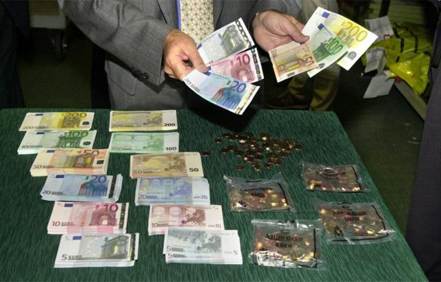 Billetes y monedas de euro. | Efe