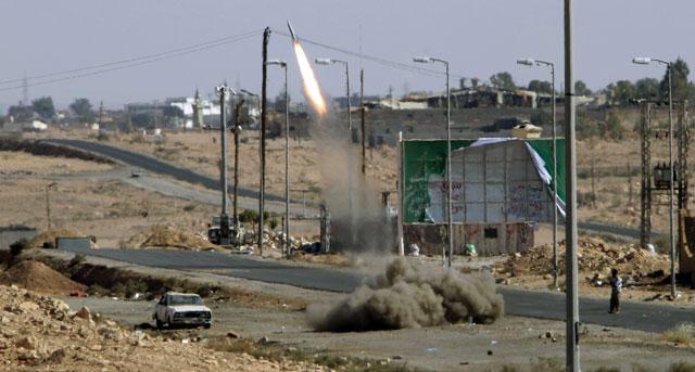 Combates en la localidad libia de Beni Walid el pasado septiembre. | Afp