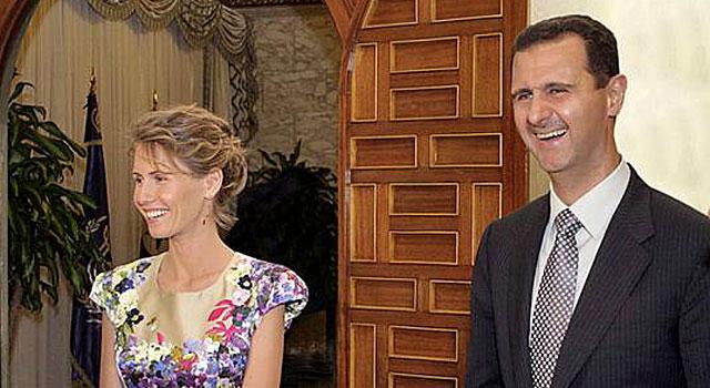 Bashar Asad y su mujer, Asma, en una recepción. | Afp