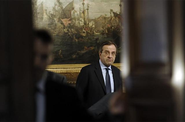 El presidente de Nueva Democracia, Antonis Samaras, antes de reunirse con Papademos.   Reuters