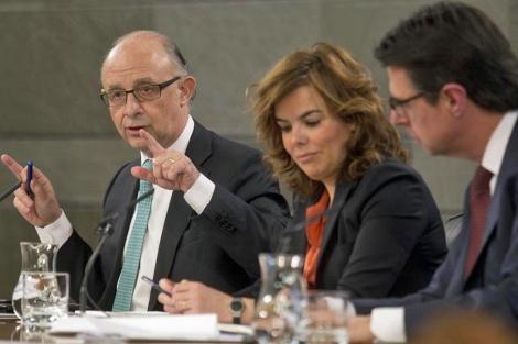 Montoro, Sáenz de Santamaría y Soria anuncia los recortes presupuestarios. | Alberto Cuéllar