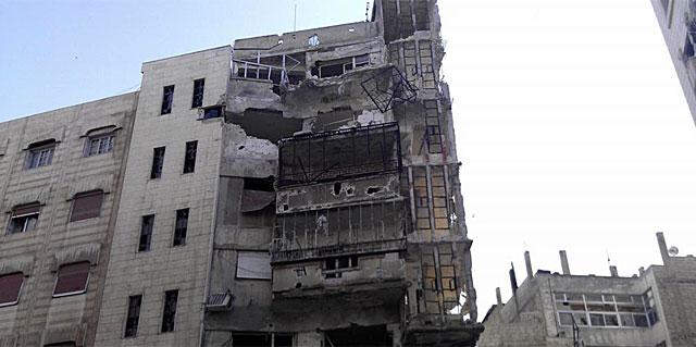 Edificio destruido por los ataques del Gobierno en Homs.   Reuters