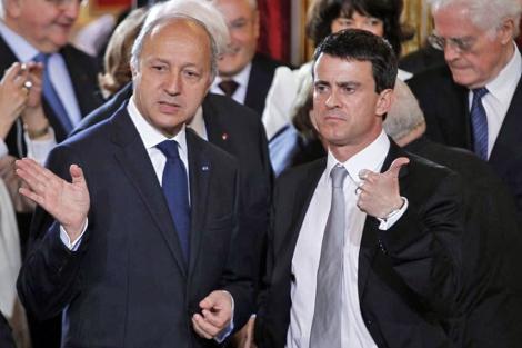 Los nuevos ministros franceses Laurent Fabius y Manuel Valls. | Reuters