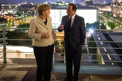Angela Merkel y François Hollande en Berlín.   Afp