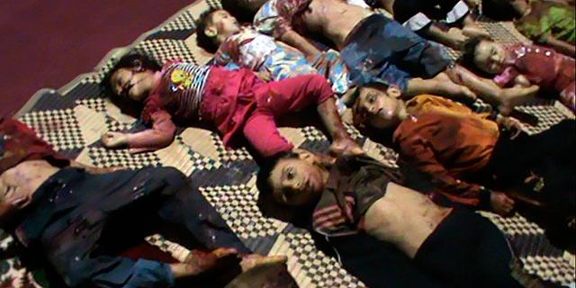 Cuerpos de varios de los 32 niños muertos en el ataque.   Reuters