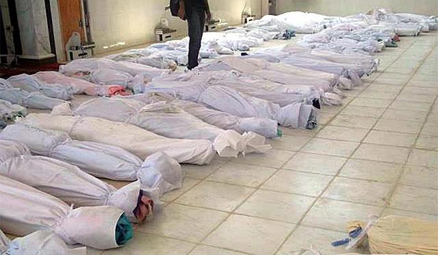 Imagen de los cadáveres de la matanza de Hula.   Efe