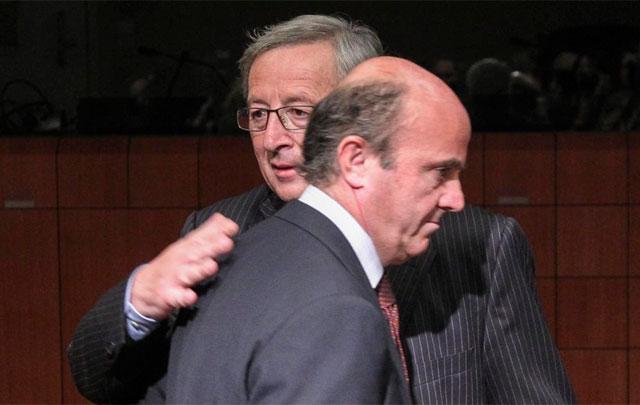 Juncker y Guindos, anoche en el Eurogrupo. | Efe