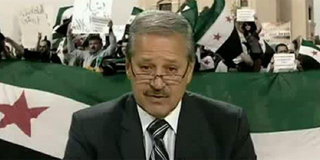 Al Fares durante la aparición en televisión en la que anunció que desertaba. | Afp