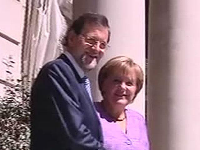Merkel y Rajoy, en la entrada de La Moncloa. | TVE
