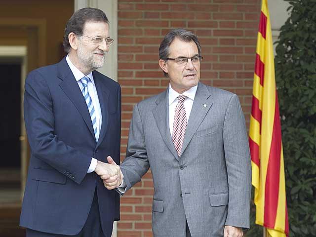 Rajoy, con Mas, en La Moncloa. | A. Cuéllar.