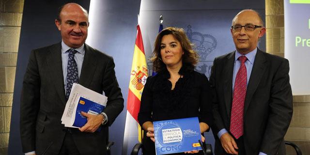 De Guindos, Santamaría y Montoro en la presentación de los PGE para 2013 este jueves. | Bernardo Díaz