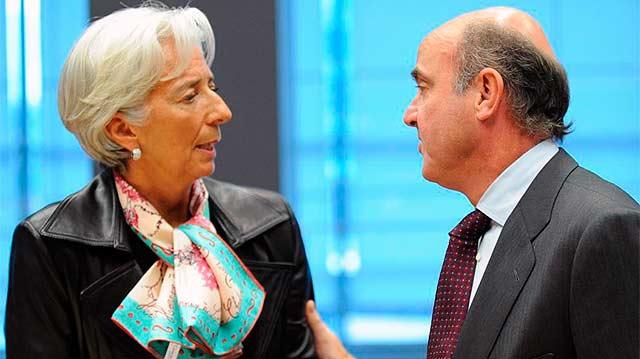 Christine Lagarde, directora del FMI, y Luis de Guindos. | Afp