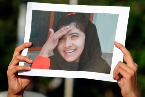 Una foto con la imagen de la niña.| Afp