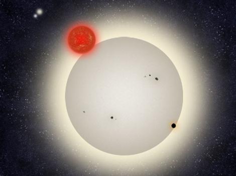El planeta PH1 orbitando en torno a sus cuatro soles. Europa Press