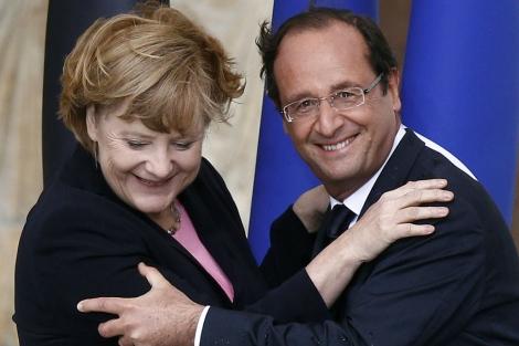 Merkel junto a Hollande.   Reuters