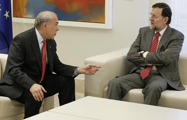 El secretario general de la OCDE, Ángel Gurría, junto a Rajoy   Efe