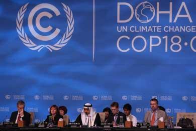 Negociaciones en la última jornada de la cumbre de Doha. | AFP