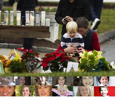 Una mujer y una niña rezan ante la escuela Sandy Hook. | Reuters