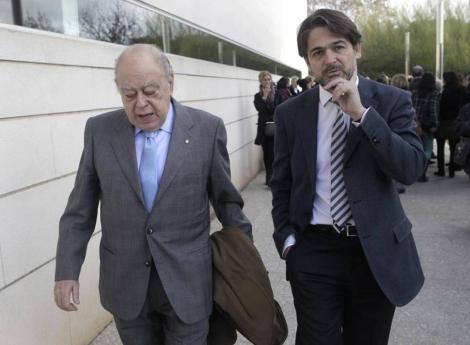 Jordi y Oriol Pujol en el funeral del doctor Moisès Broggi, el 2 de enero.   A. Moreno,