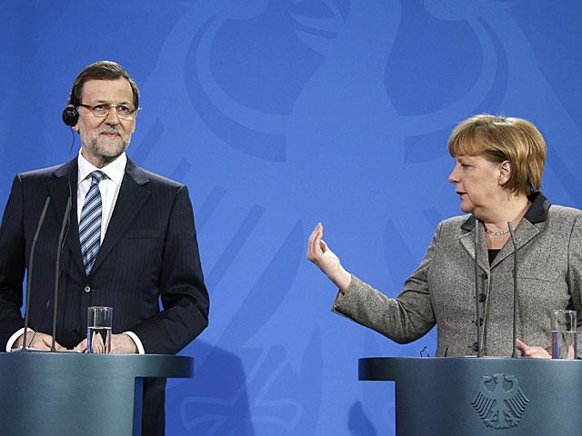 Mariano Rajoy y Angela Merkel, durante la rueda de prensa. | Fabricio Bensch / Reuters
