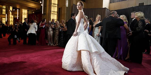 Jennifer Lawrence, de Dior Couture. | Reuters VEA MÁS IMÁGENES