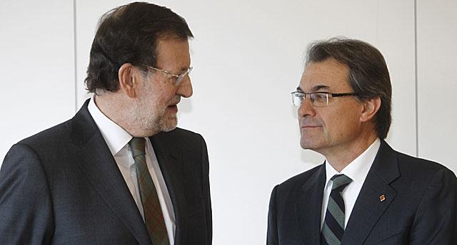 Rajoy y Mas, el pasado 8 de enero en la inauguración del AVE a Girona.   Domènec Umbert