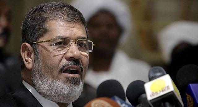 El presidente egipcio, Mohamed Mursi, durante su visita a Jartum. | Efe