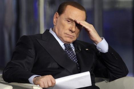 Silvio Berlusconi en un debate televisivo durante la campaña electoral. | Reuters