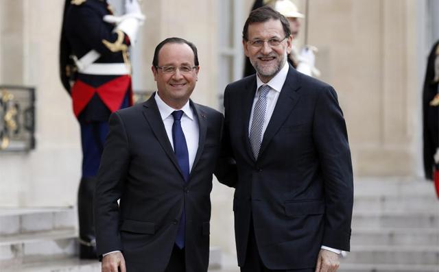 Rajoy, junto al presidente francés François Hollande. | Reuters