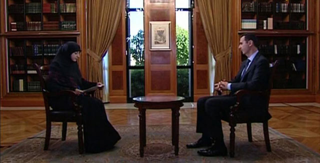 El presidente sirio, Bashar Asad, durante la entrevista ofrecida por la televisión 'Al Manar'.   Afp