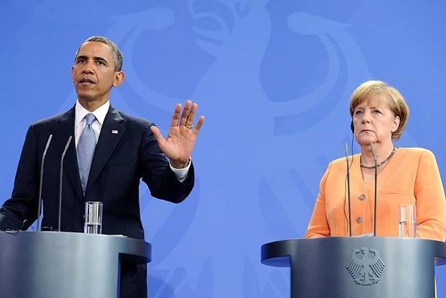 Barack Obama y Angela Merkel durante la rueda de prensa en Berlín. | Afp
