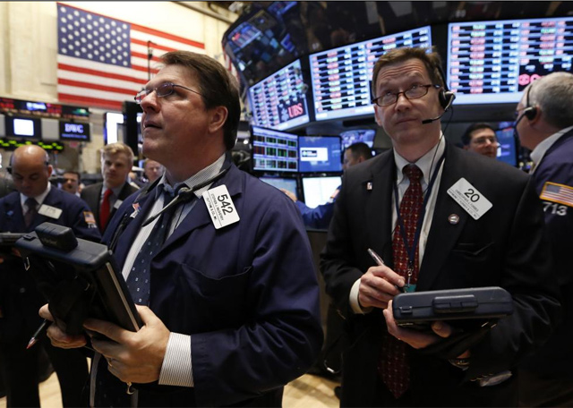 Corredores de Bolsa en Wall Street. | Reuters