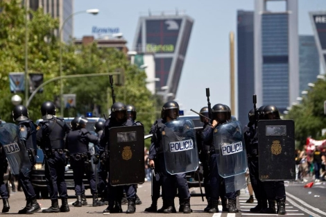 Antidisturbios en una protesta en Madrid. | Alberto di Lolli