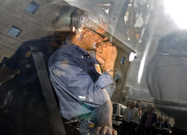 El maquinista es trasladado al Juzgado. | Rafa Rivas / Afp